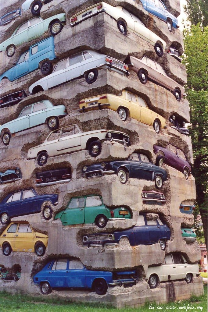 "RMAN ""Long Term Parking"", 1982, Dimensions: 1950 cm, Description : Accumulation of 60 automobiles in concrete. 19,5 m. Parc de sculpture Le Montcel, Jouy-en-Josas, France. @Deidré Wallace"