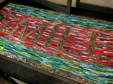 "Nadya Volicer's ""Smile"" welcome mat made from recycled toothbrushes, Image: DC Resident Tourist"